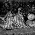 Local child asleep in Temple of Ankor Wat, Cambodia