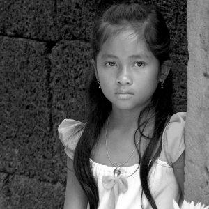 Cambodian girl in Temple of Banteay Syrei, Cambodia