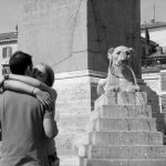 Couple romancing at the foot of obelisk in St. Peter's Square, Rome