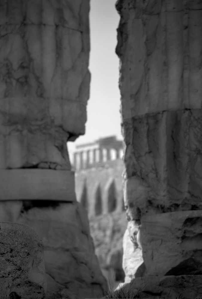 View of Parthenon from ancient temple ruins below , Athens, Greece