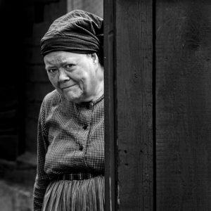 Elderly woman in period costume at Skansen open air museum, Stockholm, Sweden