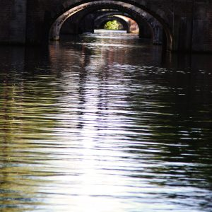 A view through multiple canal bridge archways, Amsterdam, Netherlands