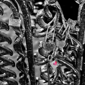 Canal gate with dated locks of love, Amsterdam, Netherlands
