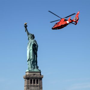 A tourist helicopter circles the Statue of Liberty, New York