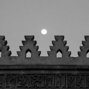 The moon rises over the ancient city walls of Cairo, Egypt