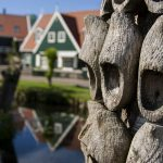 A large pole covered in wooden clogs just outside a small shoe factory, Marken, Netherlands