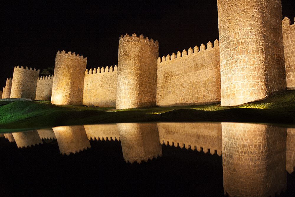 Car roof reflections of medieval stone wall, Avila, Spain
