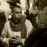 An Egyptian man ponders his next move in the Khan Al-Khalili market, Cairo, Egypt