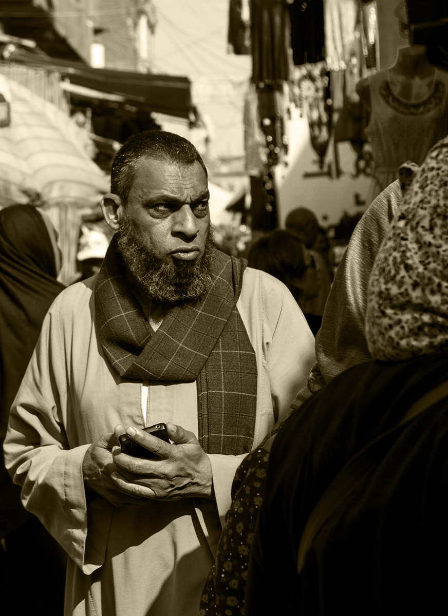 An Egyptian man ponders his next move in the Khan Al-Khalili market, Cairo, Egypt