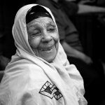 An Egyptian woman is gives a warm smile in the Khan Al-Khalili market, Cairo, Egypt