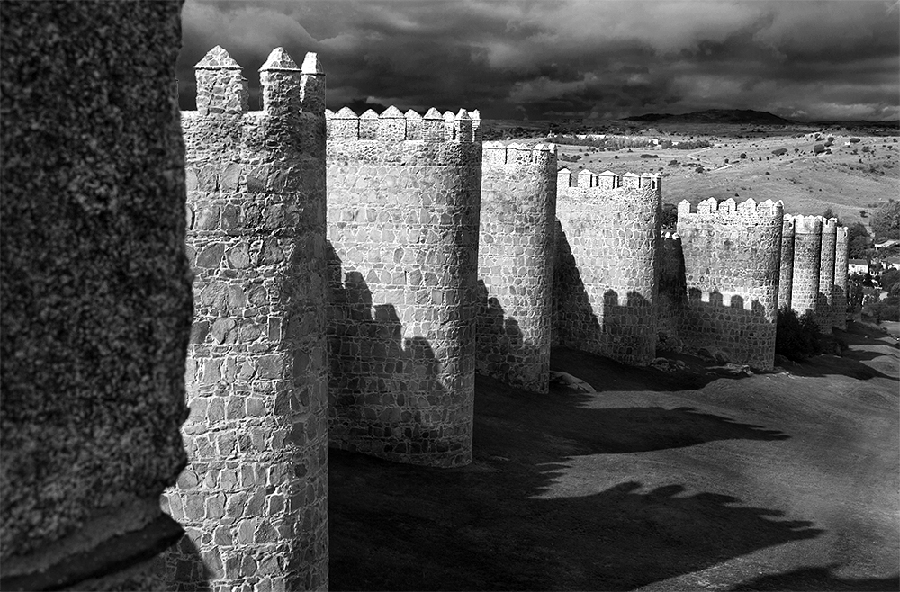 Medieval stone wall surrounding the town of Avila, Spain