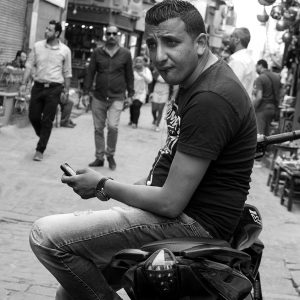 "A young Egyptian man leaning on his cycle does his best ""James Dean"", Khan Al-Khalili market, Cairo, Egypt"