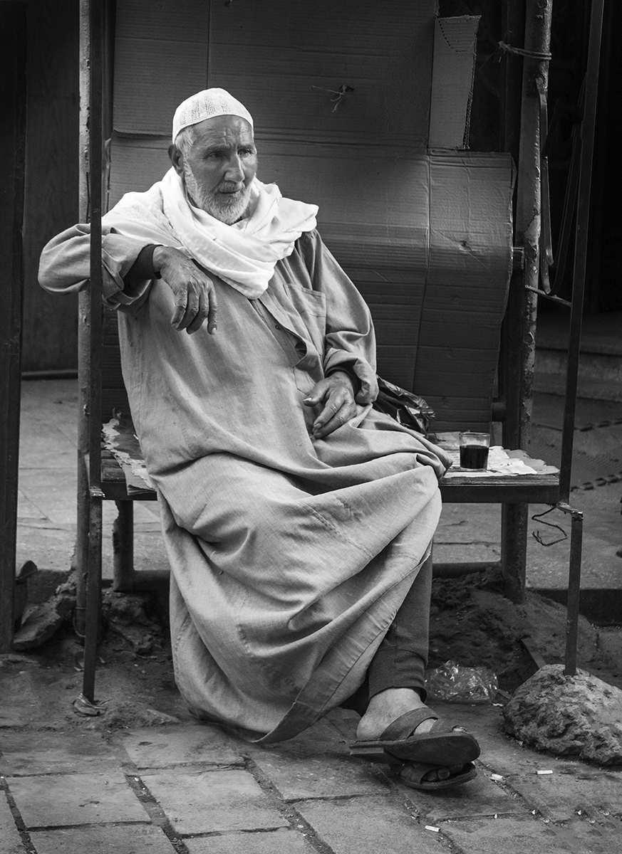 An elderly Egyptian man enjoys his afternoon tea in the Khan Al-Khalili market, Cairo, Egypt