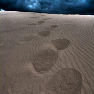 Storm clouds over sand dunes in North Jutland , Denmark