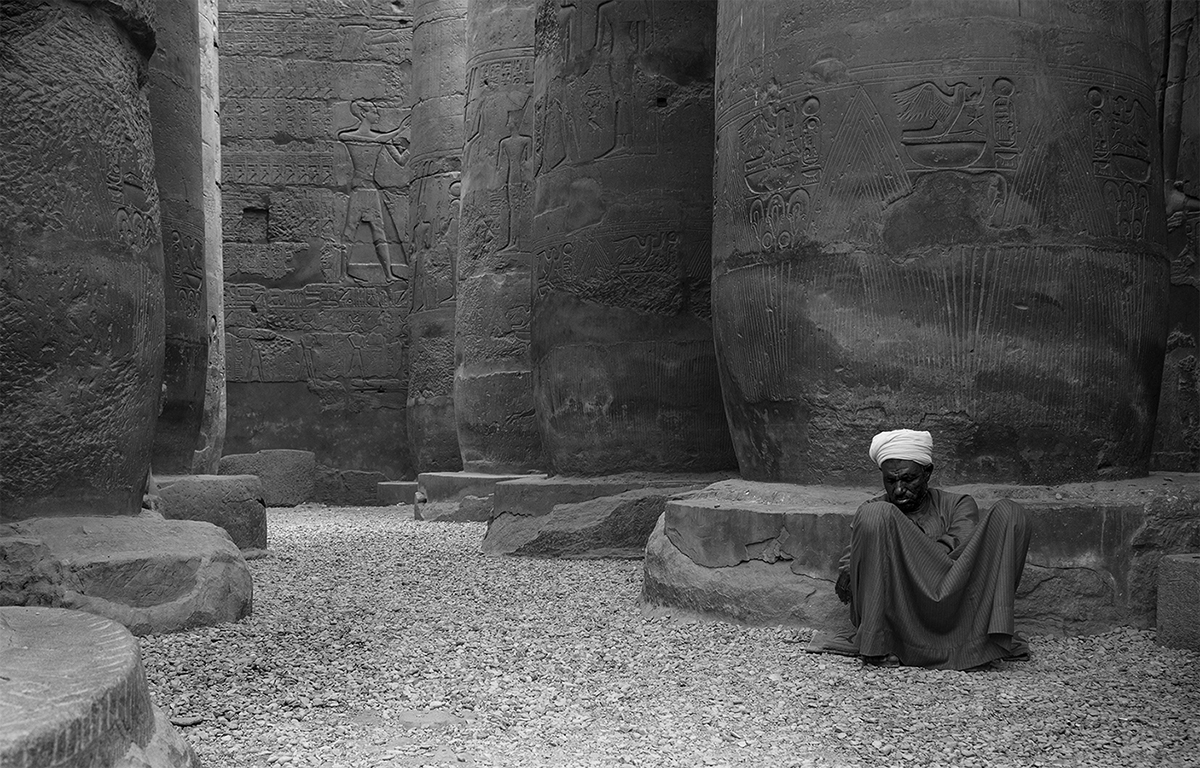 A curator takes a nap within the Temple of Luxor, Luxor, Egypt