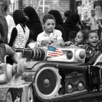 Children enjoying an amusement ride during a local festival, Luxor, Egypt