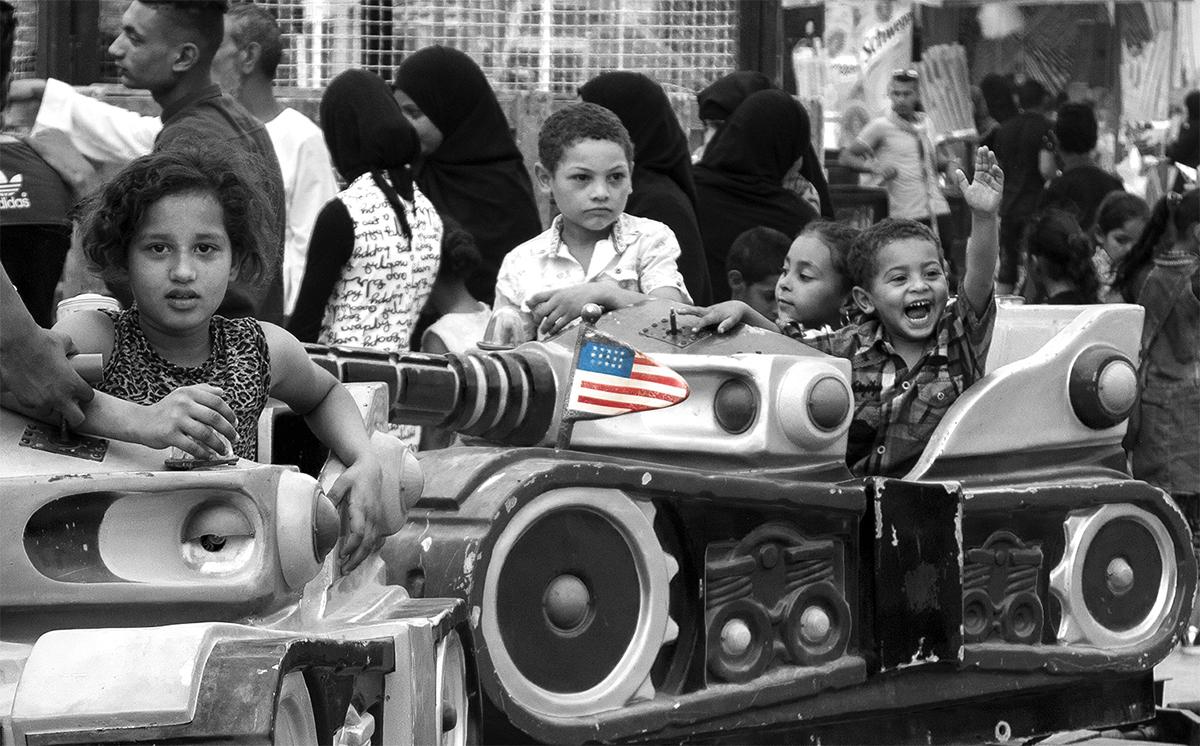 Children enjoying an amusement ride during a local festival, Luxor, Egypt