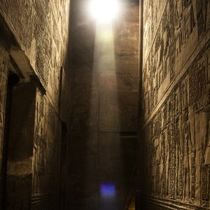 Light streams in through an upper wall opening at the Temple of Horus, Edfu, Egypt