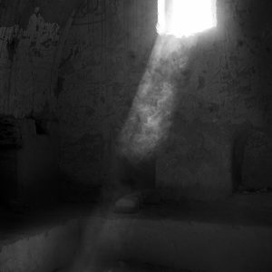 Light streams through a cell window of St Simeon's 6th century Coptic Christian Monestery, Aswan, Egypt
