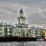 Public buildings along the Neva River shot through a rain-slicked cruise boat window, St. Petersburg, Russia