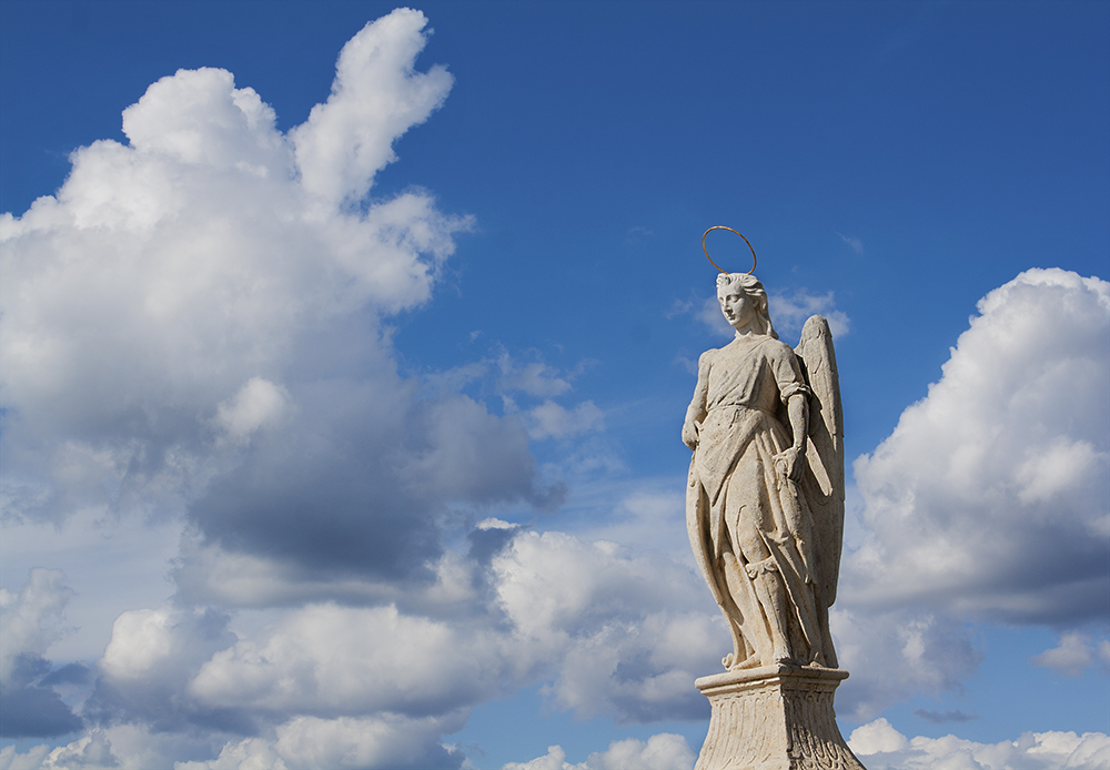 Statue on bridge leading into medieval town of Cordoba, Spain