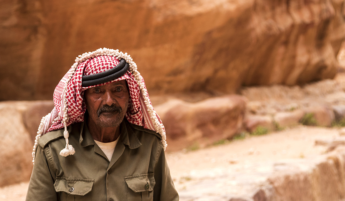 A local curator among the ancient Petra city, Petra Ruins, Jordan