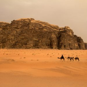 A local bedouin passes through and ancient path forged by his ancestors, Wadi Rum, Jordan