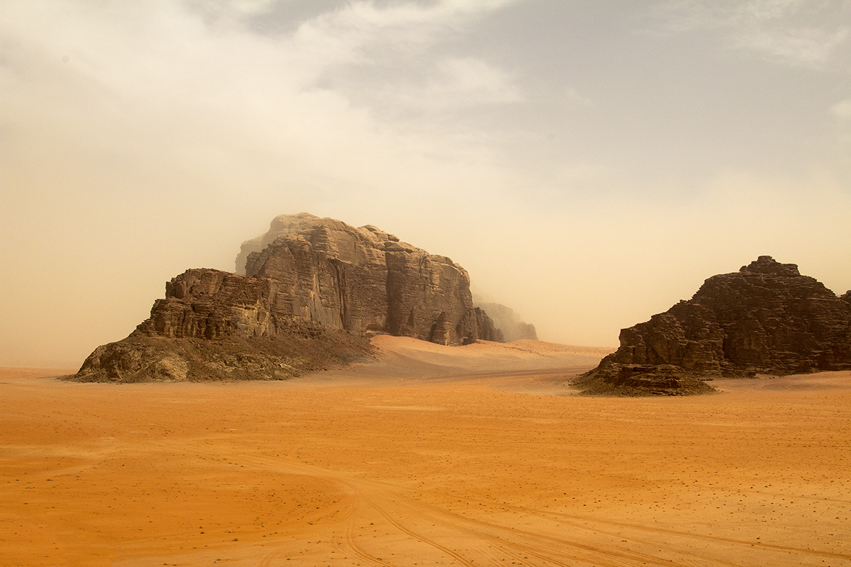Colossal weathered rock formations slowing succumbing to the sands of time, Wadi Rum, Jordan