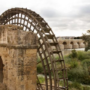 Mill water wheel with Roman bridge in Cordoba, Spain