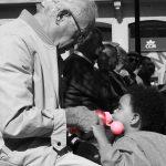 Grandfather feeding granddaughter