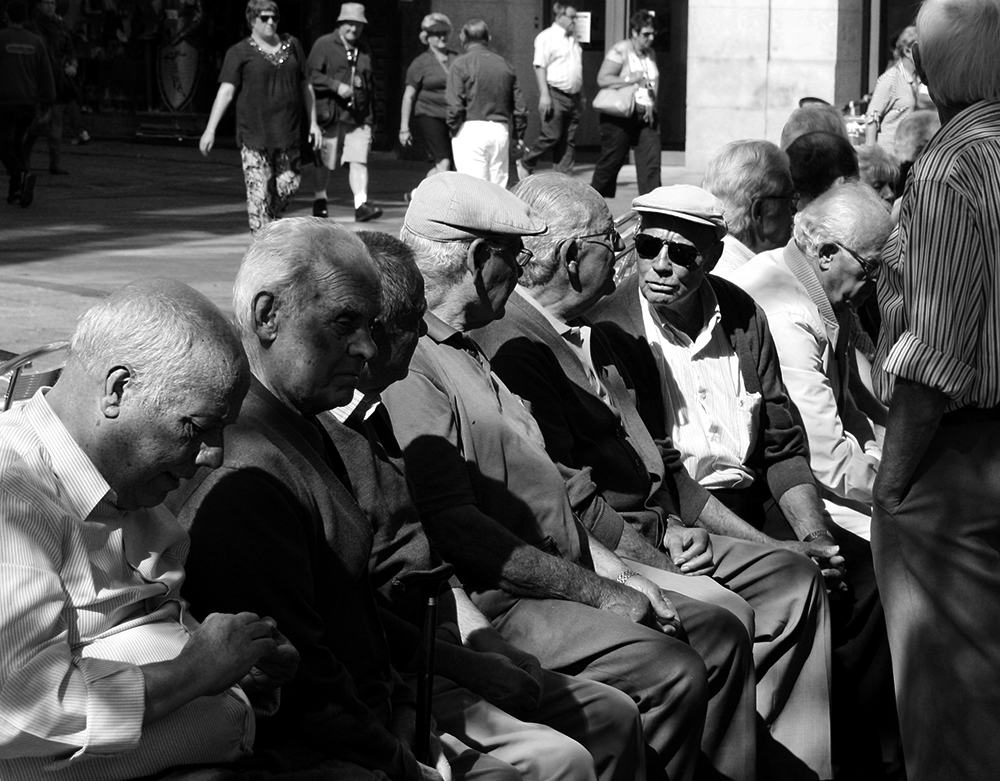 The gathering of local retired men in public square at Toledo, Spain