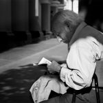 An elderly local enjoys a relaxing afternoon reading the paper, Lima, Peru
