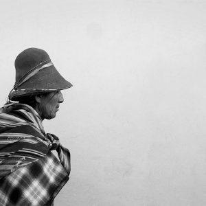Quechua native wanders the streets of Cusco, Peru