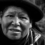 An elderly artisan gives a warm welcome in her native Quechua language, Tambomachay, Peru