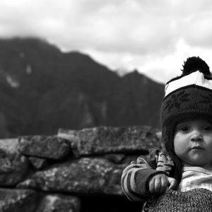 A Peruvian tourist among the Incan ruins of Machu Picchu, Peru