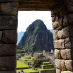 Incan ruin doorway at Machu Picchu with Huayna Picchu in the background, Peru