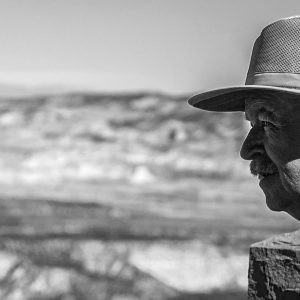An elderly tourist stares out across the vast and timeworn canyon, Bryce Canyon NP, Utah