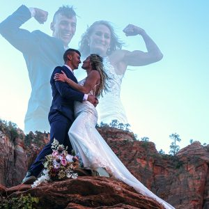 A young couple poses after a sunrise wedding atop a canyon outlook, Zion NP, Utah