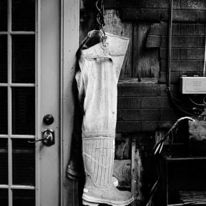 A pair of waiters hang near a Locke resident's alley door, Locke, CA