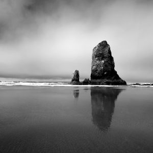 A pair of lone sea stacks fight back the waves for eons along the Oregon coast