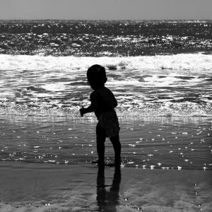 A toddler stands in awe of the vast Pacific Ocean, Trinidad Beach, CA