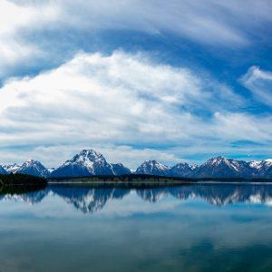 The entire range of Tetons reflect across Jackson Lake, Grand Tetons NP, WY
