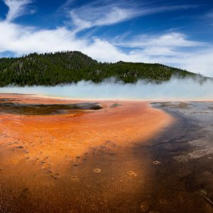 Various colored microbes create a remarkable painted canvas surrounding the Grand Prismatic Spring, Yellowstone, WY